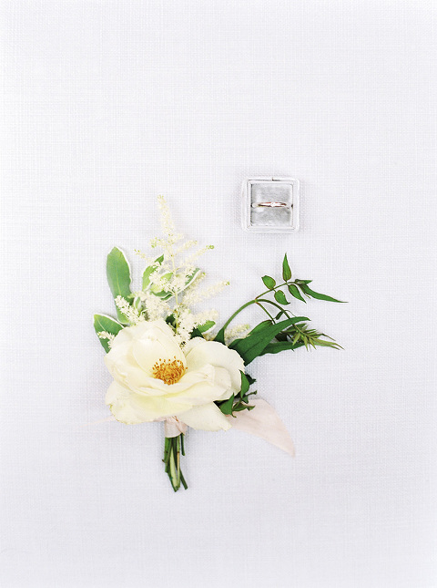 Floral buttonhole with wedding ring luxury wedding planned by Kim B